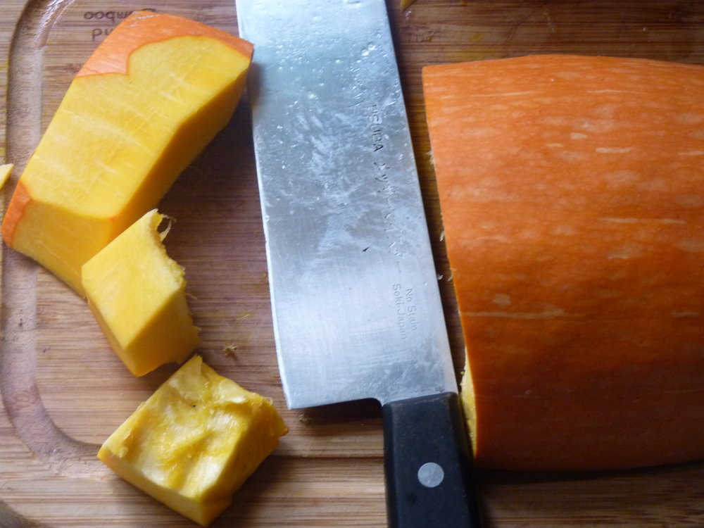 Cubing and peeling the squash. I find it easier to cube first and then peel the cubes or small slices.