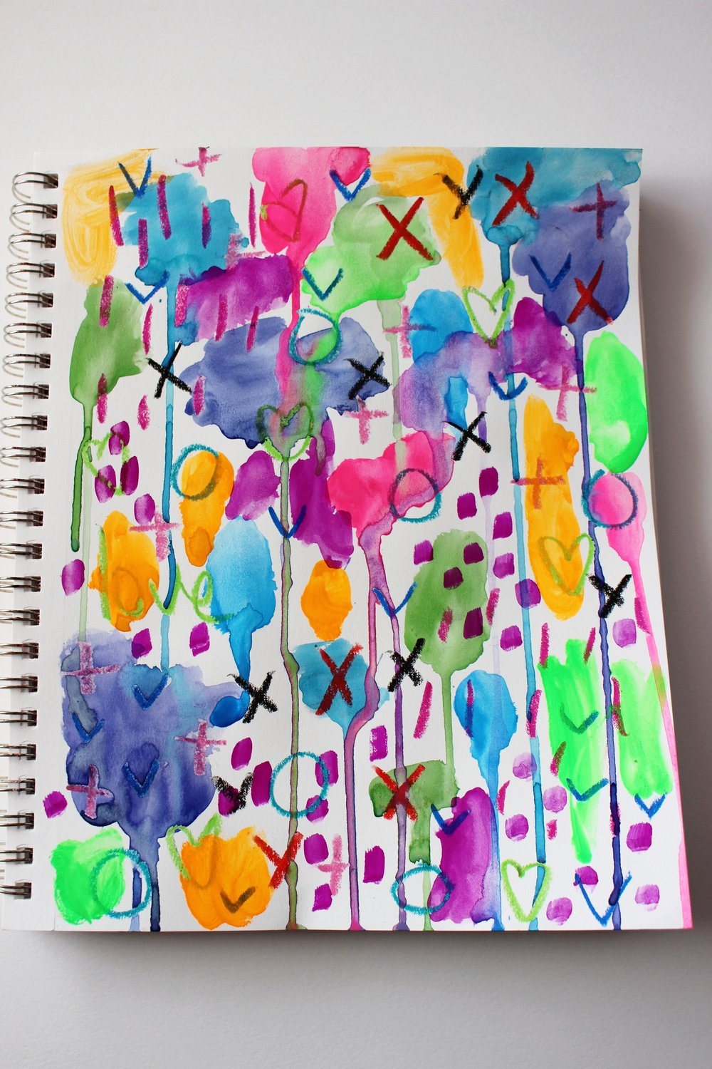 tip: lift up the surface while watercolors are still wet to create drips