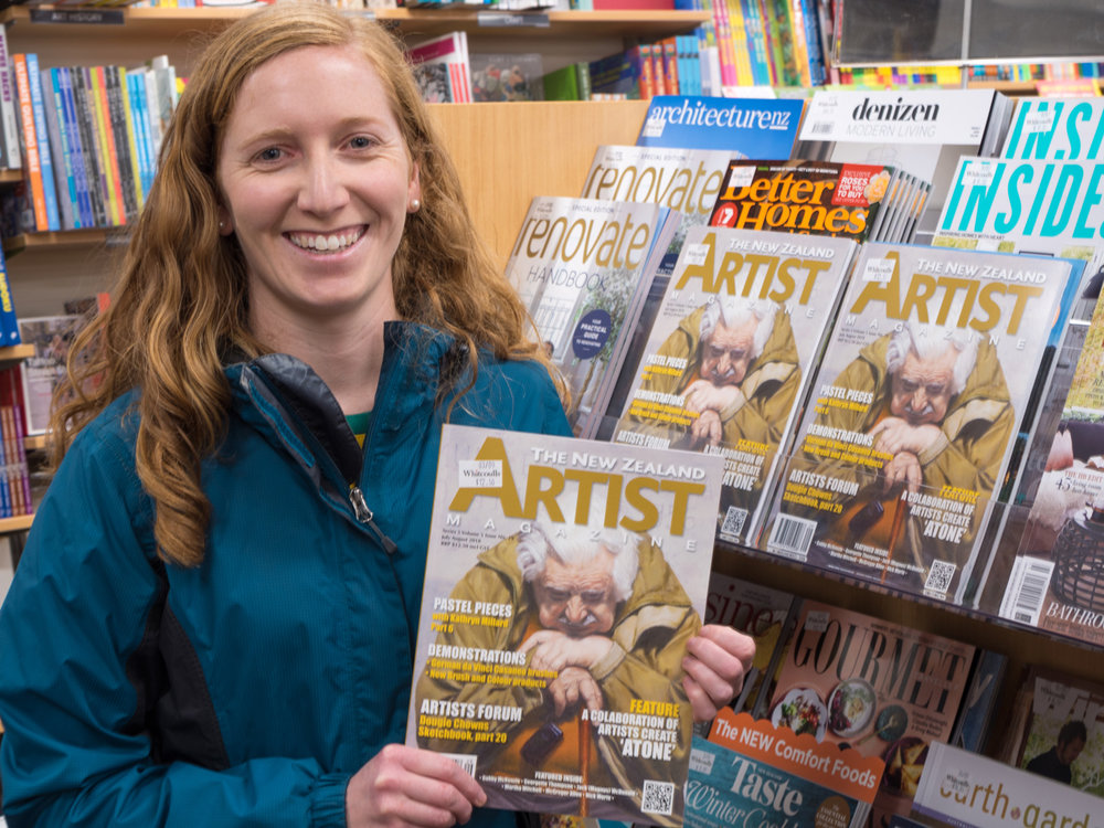 A very excited Georgette holding her cover of the New Zealand Artist magazine at the local bookstore.