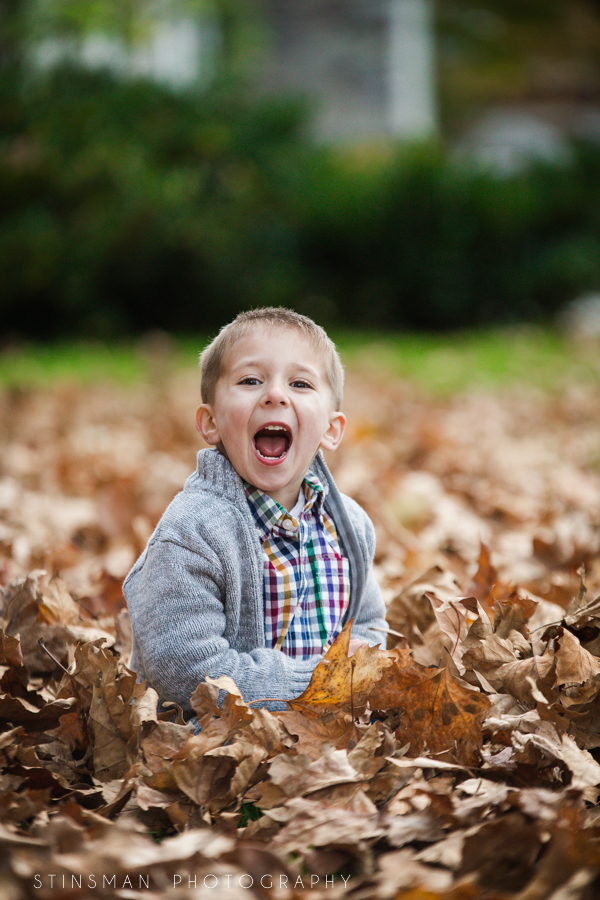 Smiling son in leaves
