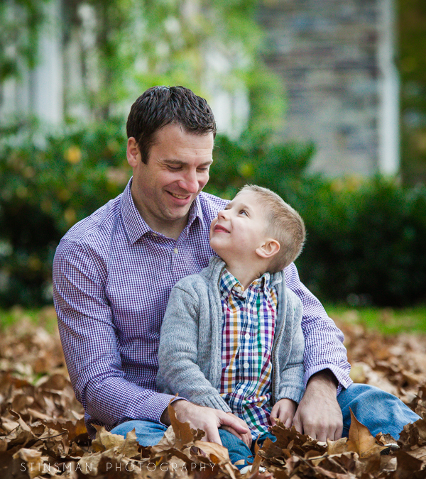 father and son sitting in leaves at princeton university