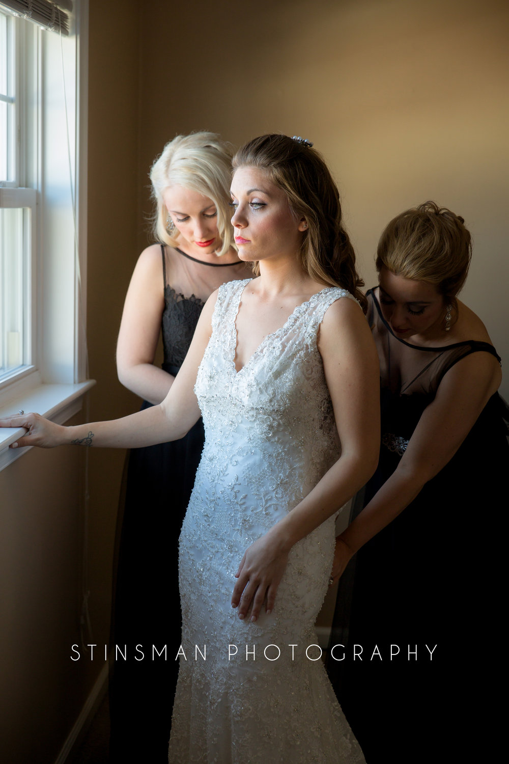 bride getting into her wedding dress