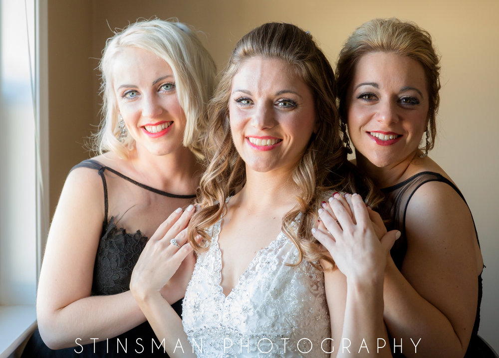 bride with her sisters in a photo