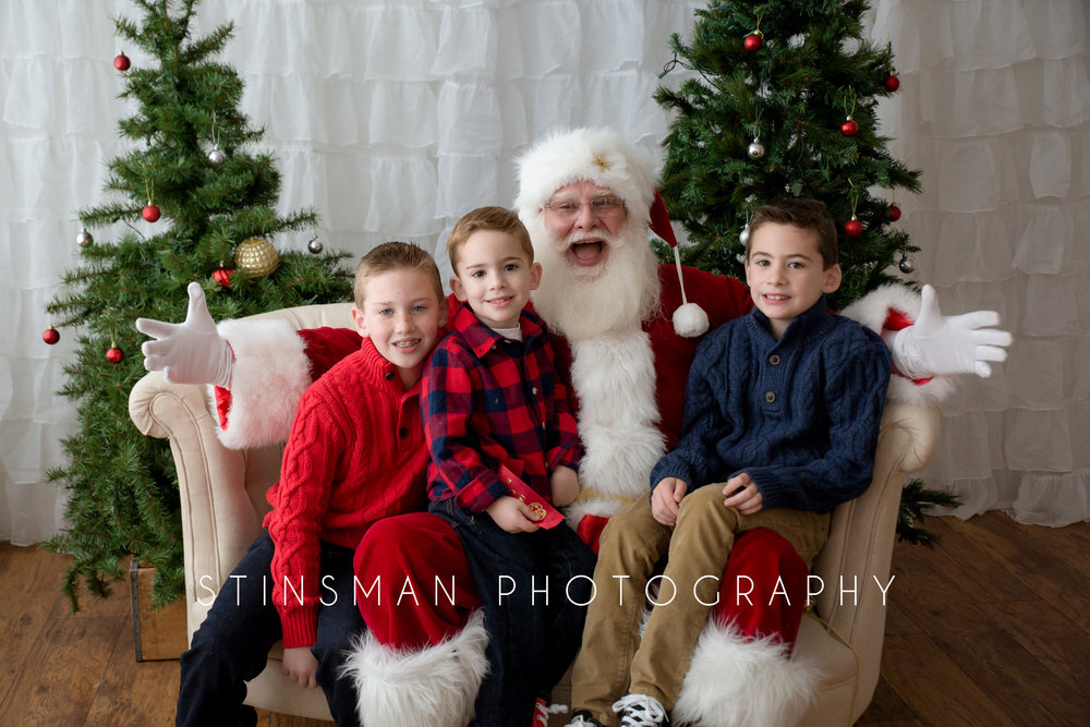 three brothers sitting on Santa's lap