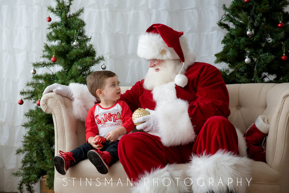 little boy looking at Santa