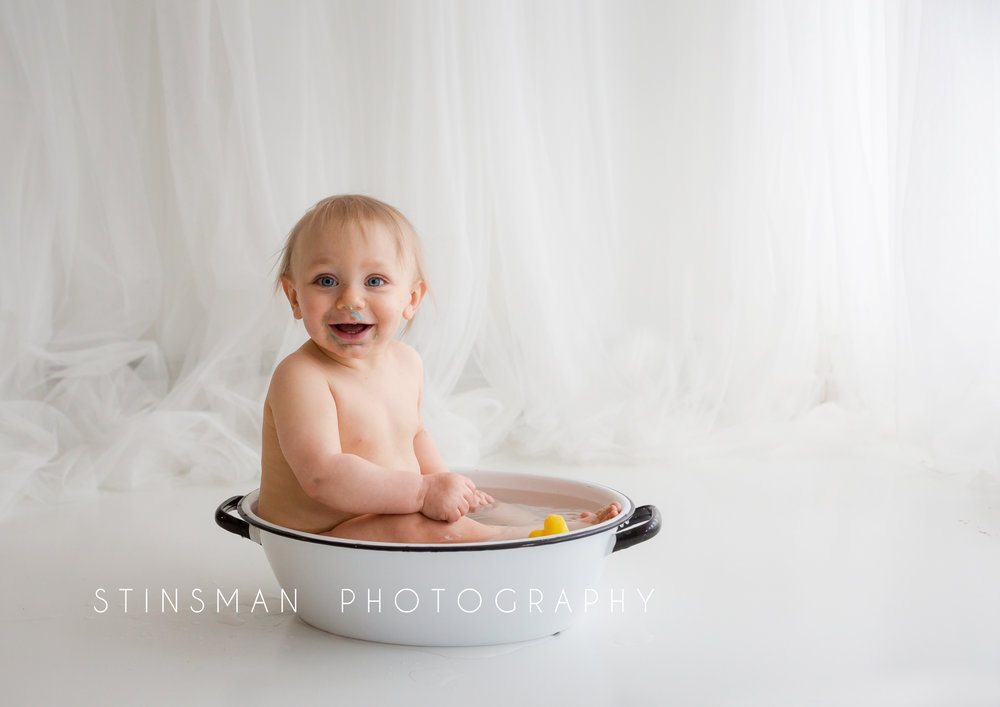 smiling baby in the tub