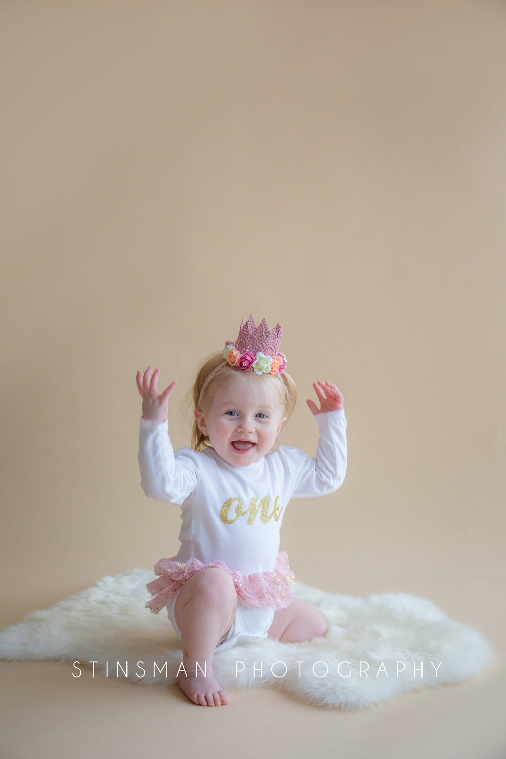 little girl wearing a crown for her first birthday photos