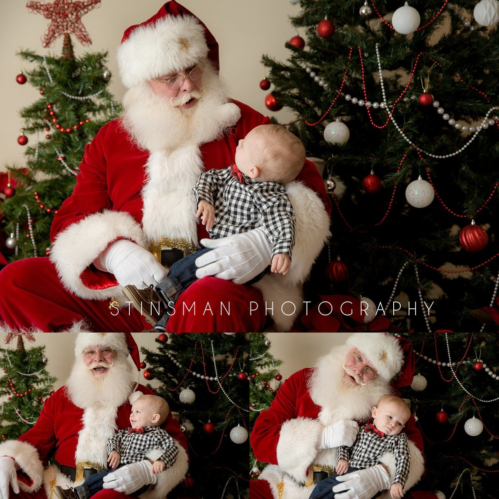 little boy wearing a checkered shirt sitting with santa