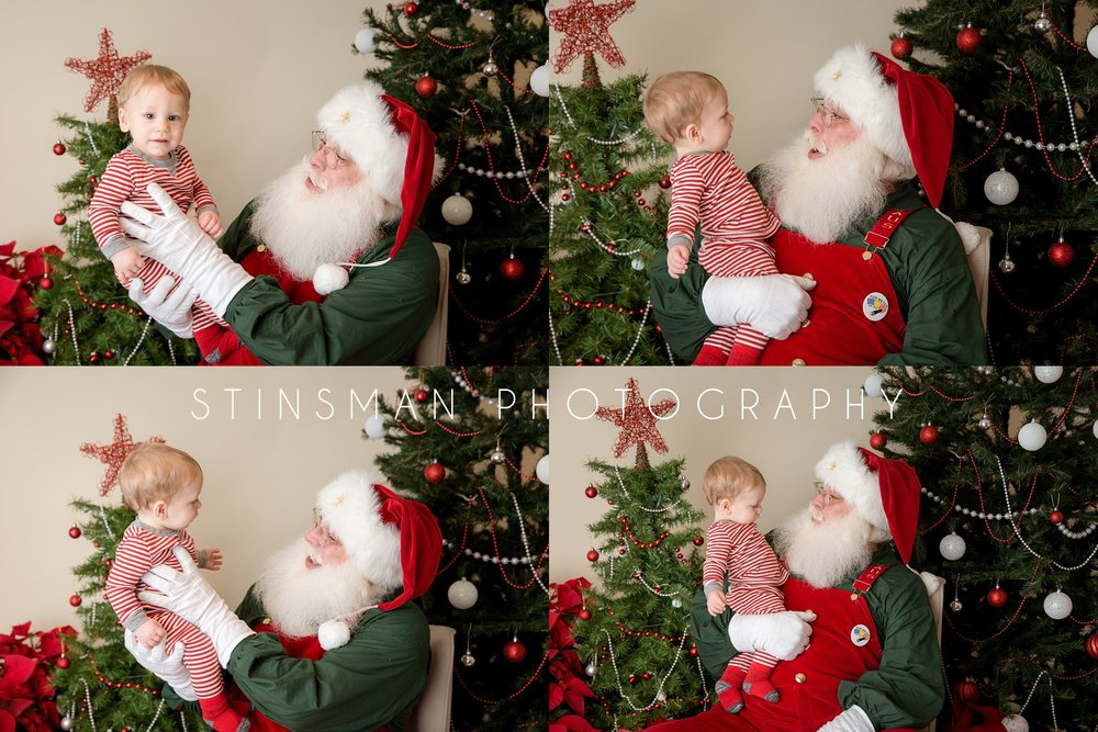 baby boy wearing striped red pajamas sitting on santa's lap new jersey photographer