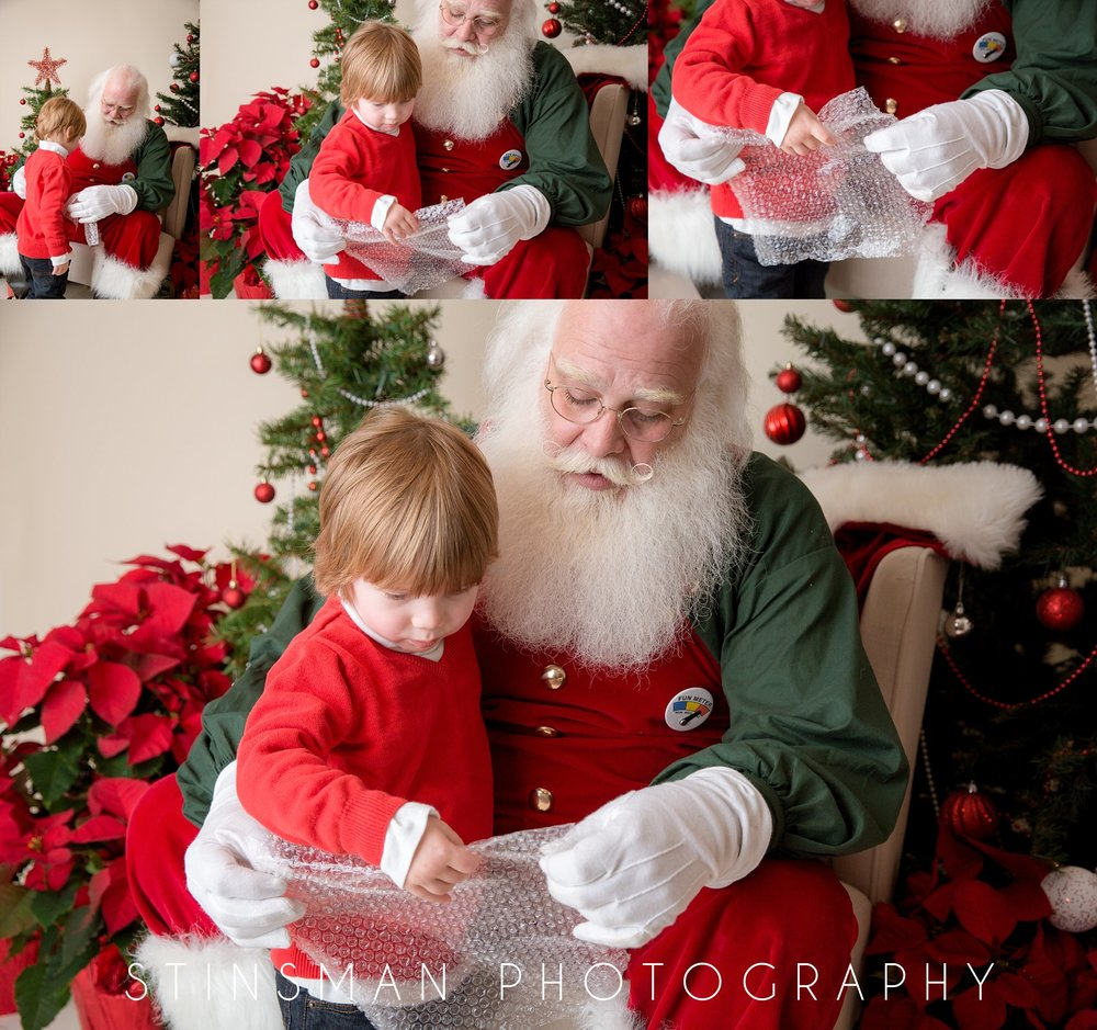 little boy loves bubble wrap and shows santa. new jersey photographer