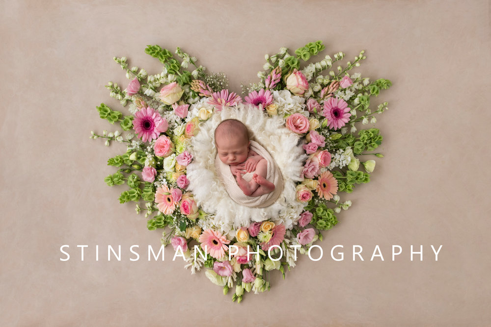 newborn baby girl in a beautiful flower art piece new jersey newborn photographer