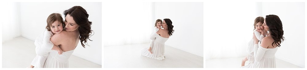 mom and daughter hugging and laughing for pregnancy photos