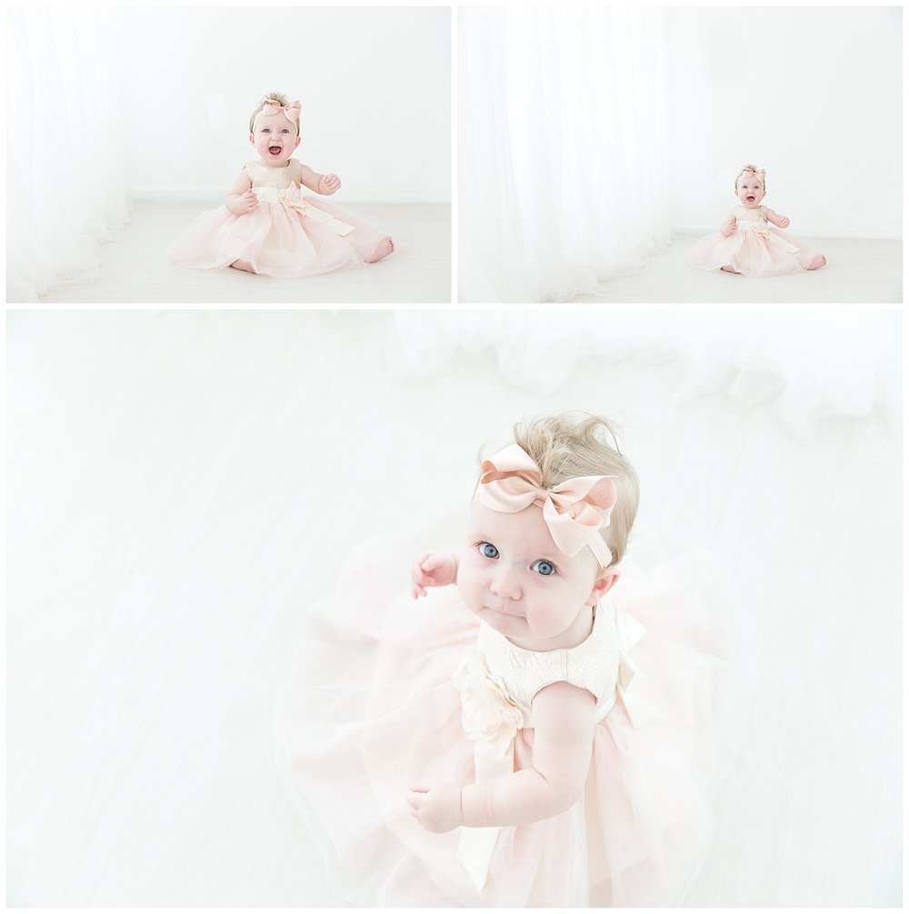 one year old girl wearing rose gold for her first birthday photos in burlington nj