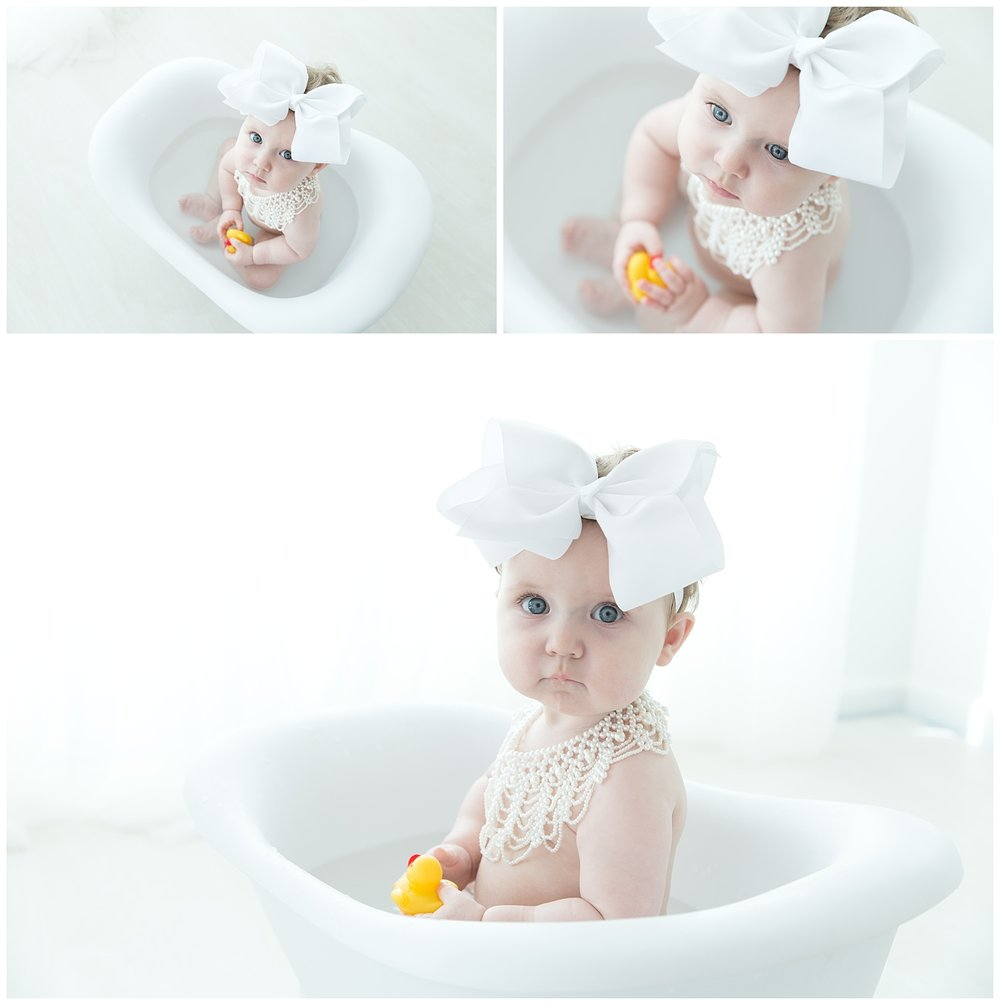 big beautiful blue eyed baby girl in the tub for her birthday photos in burlington nj