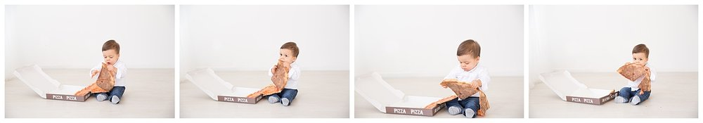 one year old baby boy eating pizza for his first birthday photo shoot on burlington new jersey