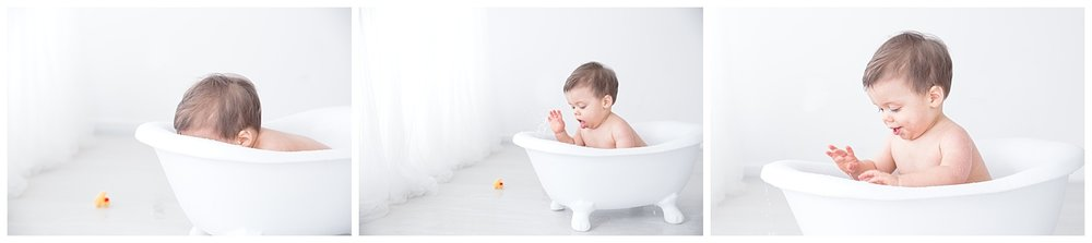 splashing in the tub for his first birthday photo shoot in burlington new jersey