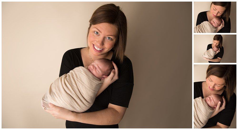 mom holding newborn baby boy in a black shirt and cream wrap in newborn photo studio in burlington new jersey