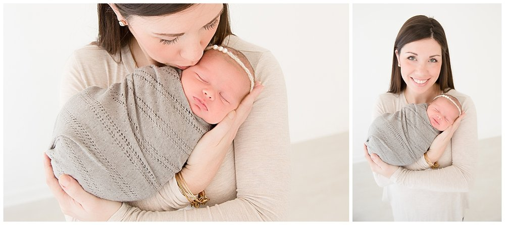 mom holding her newborn baby in south jersey newborn photo studio