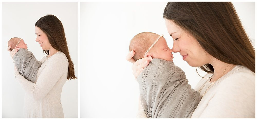 mom snuggling her newborn baby girl and giving eskimo kisses in newborn photo shoot in burlington new jersey studio