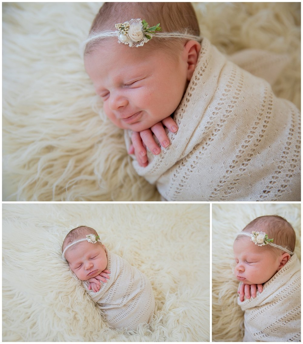 baby girl smiling while wrapped in cream for her newborn photos in burlington new jersey