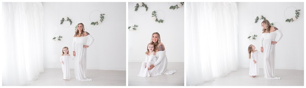 mom and her daugher wearing white in the burlington nj photo studio for photos