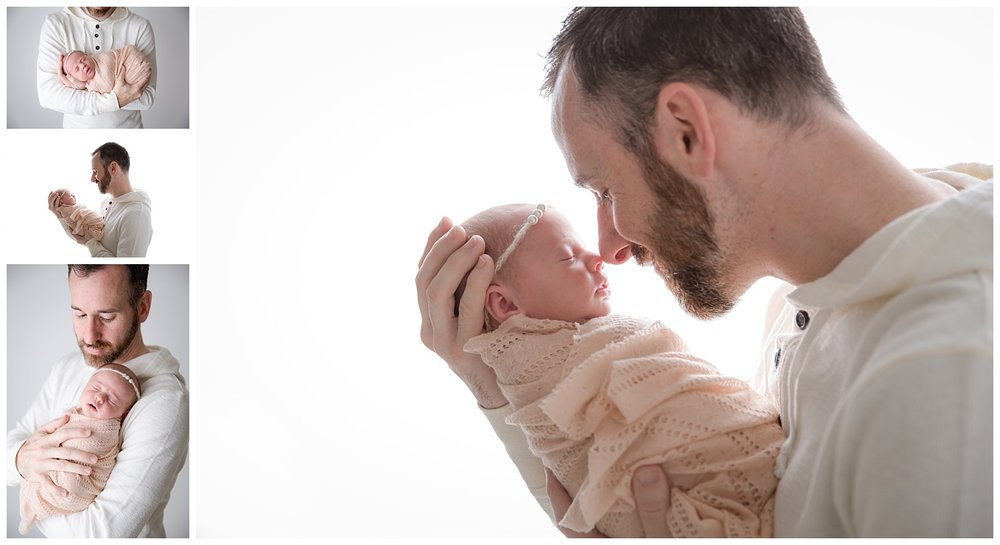 dad snuggling his newborn baby girl for pictures in burlington new jersey studio