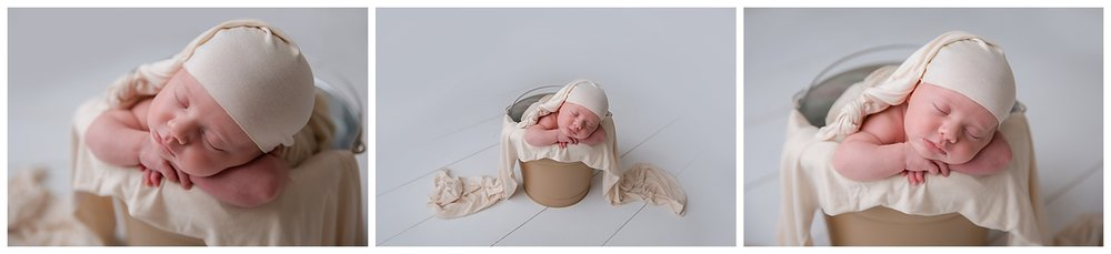sleeping baby in a bucket wearing cream in moorestown new jersey photo studio