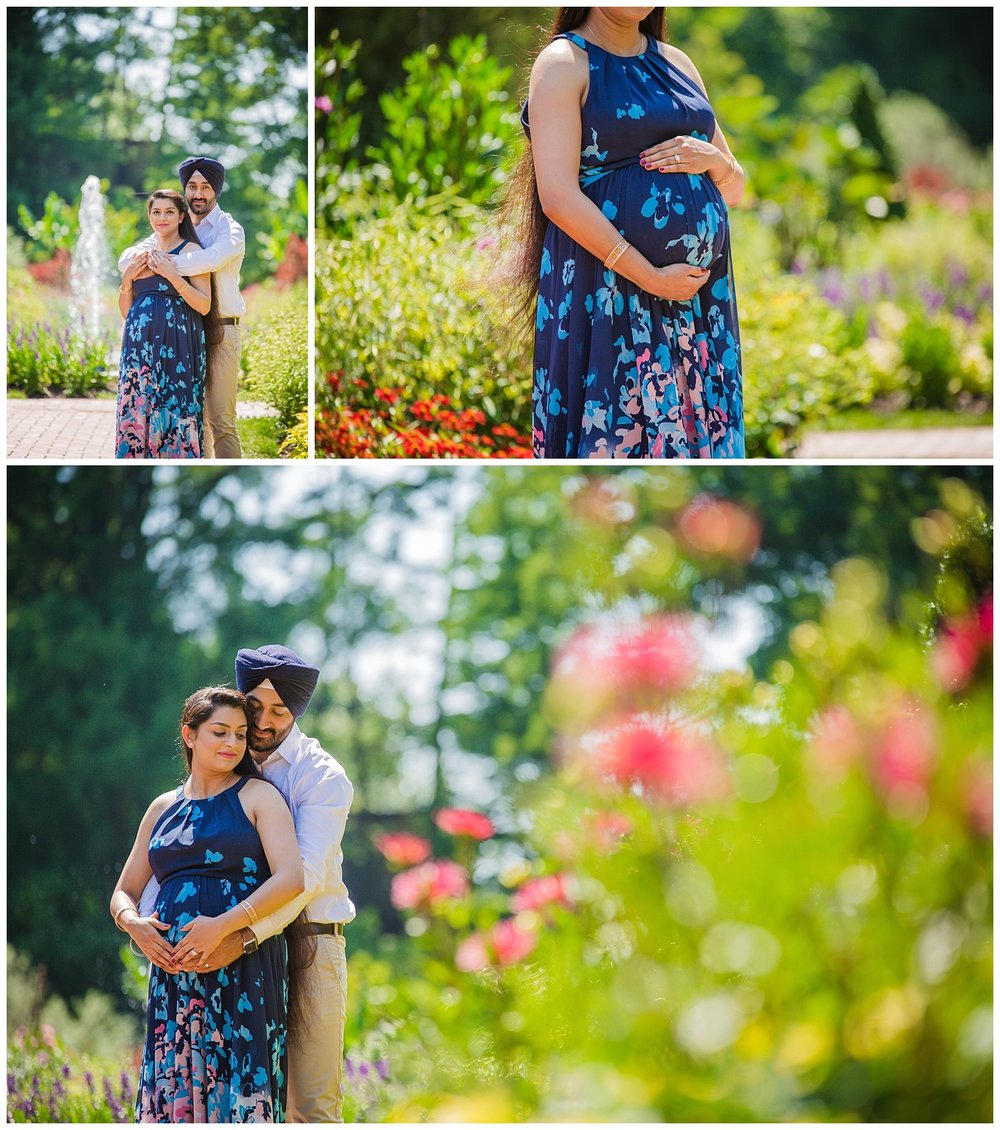 husband hugging his pregnant wife in the beautiful gardens of longwood philadelphia pa