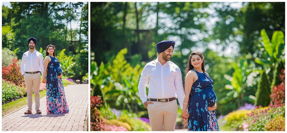 maternity photo shoot at longwood garden with mom wearing a blue dress and dad a blue turban
