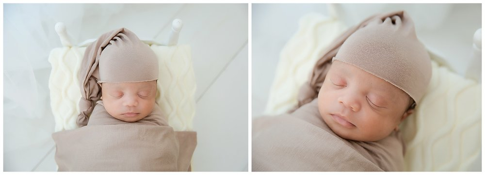 african american baby in a brown wrap sleeping in burlington nj studio
