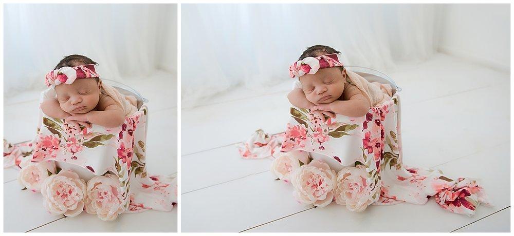 newborn baby girl in floral peony pattern in burlington nj studio