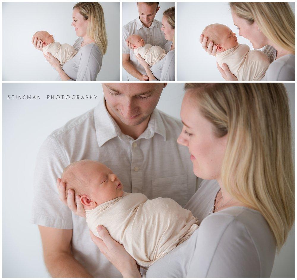 mom holding her newborn baby boy in moorestown new jersey photo studio