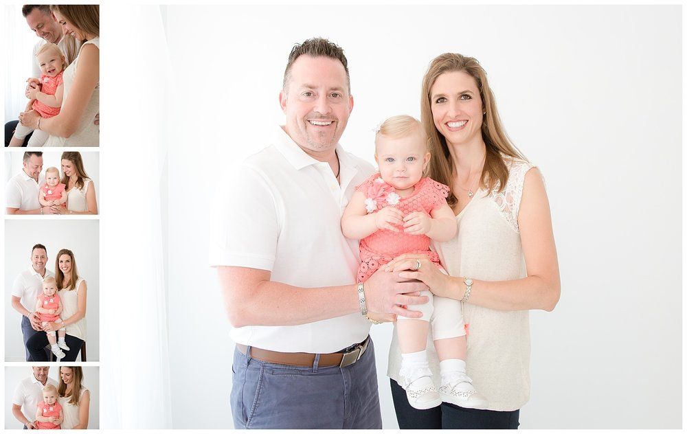 new jersey moorestown family session in white photo studio parents holding their one year old girl
