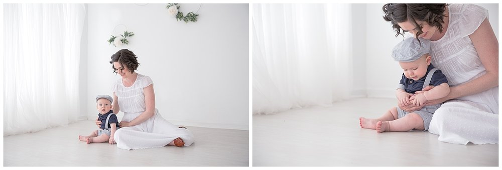 mom playing with her little boy on the floor wearing a white dress in moorestown new jersey studio