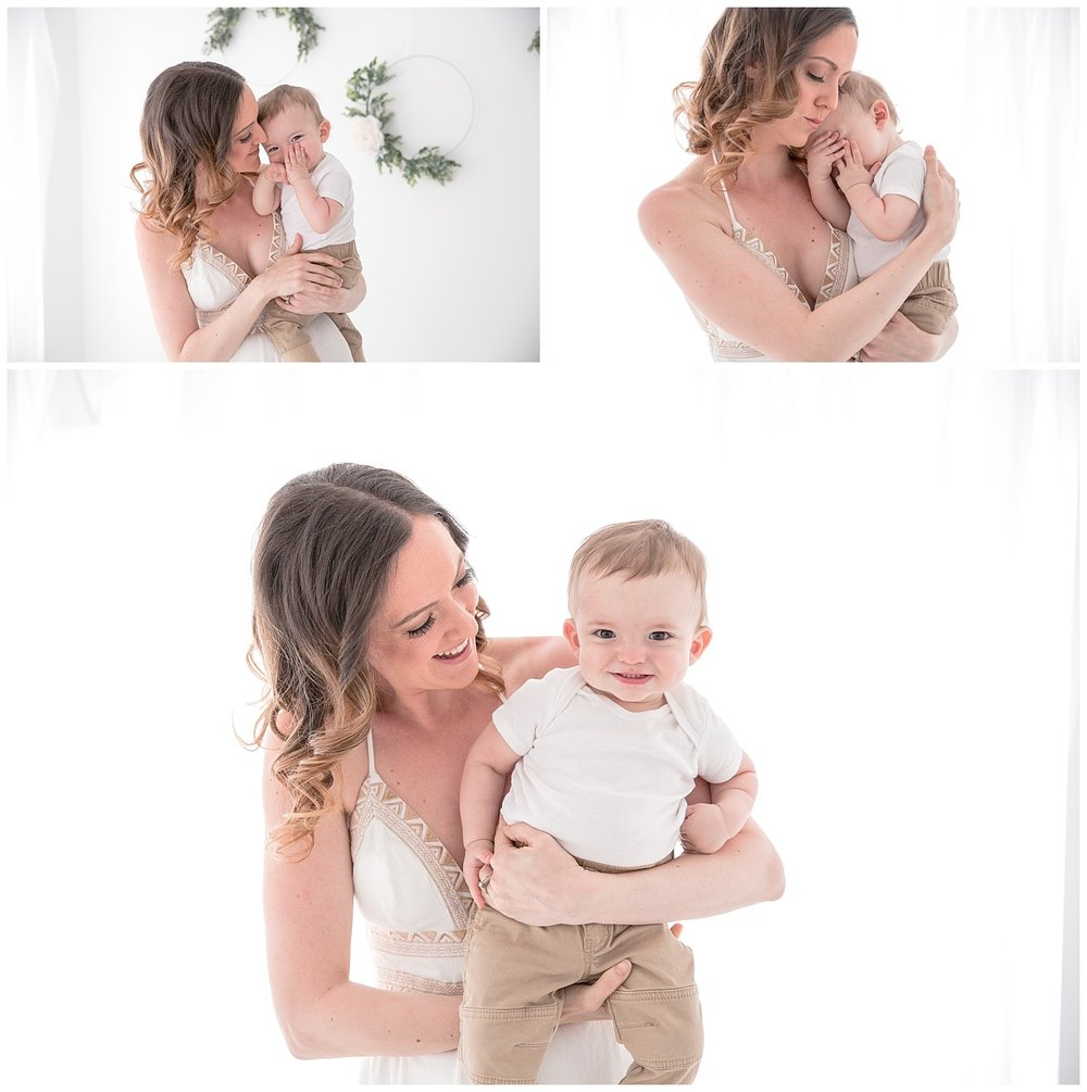 mom holding her 9 month old son in white studio in moorestown new jersey