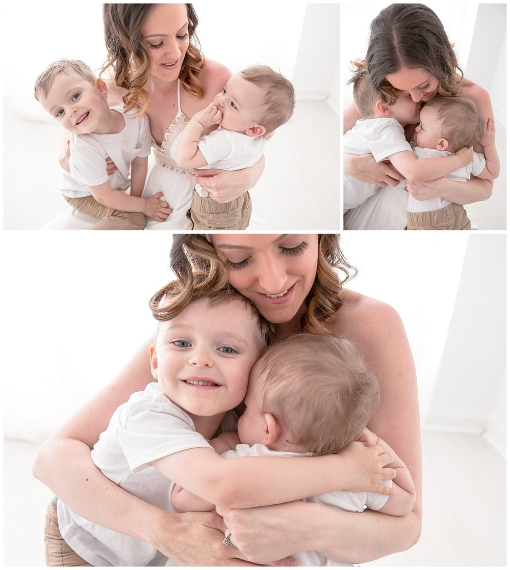 mom holding her two boys in mommy and me session in burlington new jersey photo studio