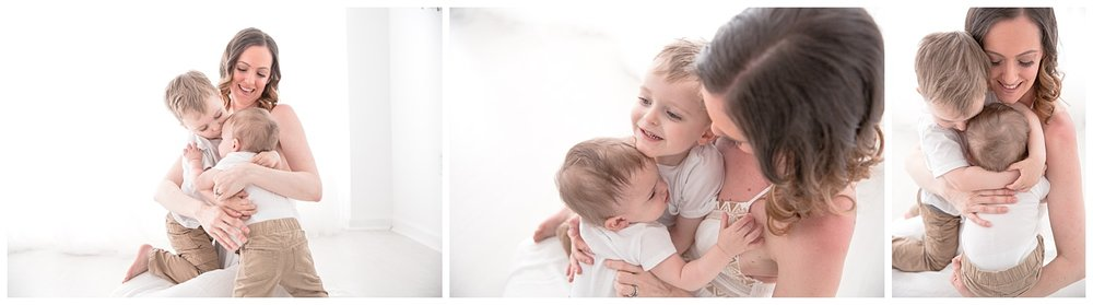 mom hugging her little boy in white shirts and khaki pants in burlington new jersey photo studio