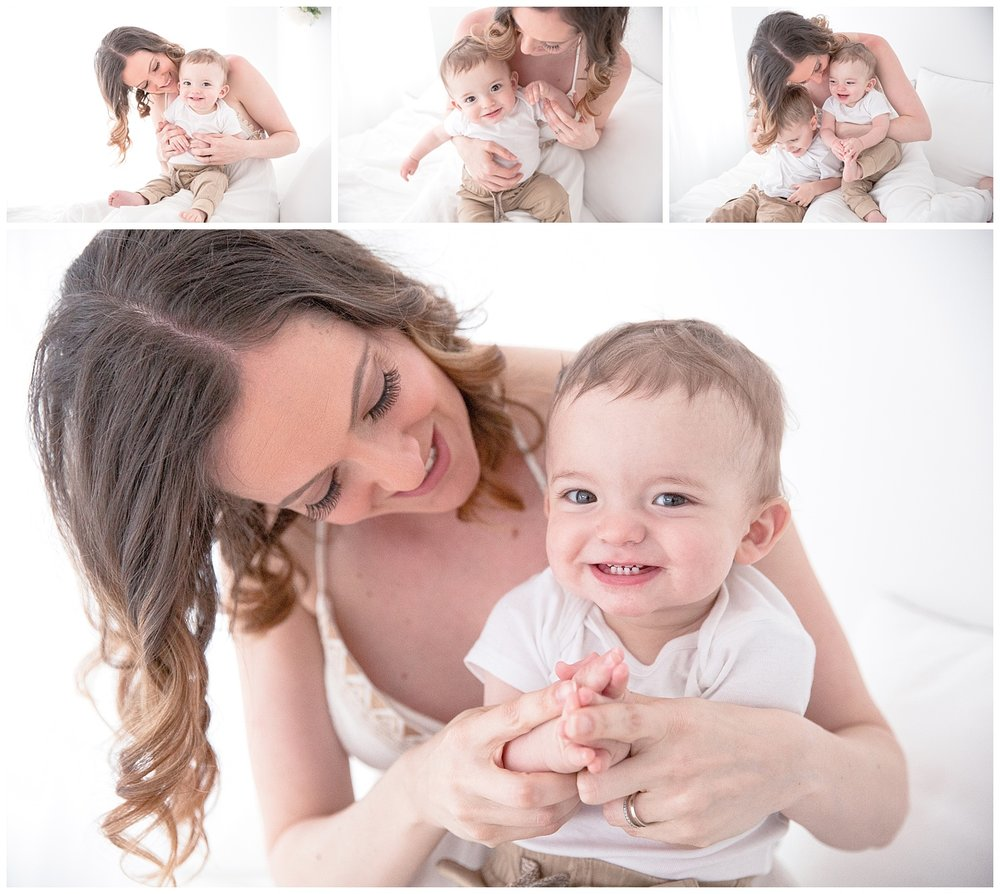 9 month old baby sitting with his mom and smiling in moorestown new jersey studio