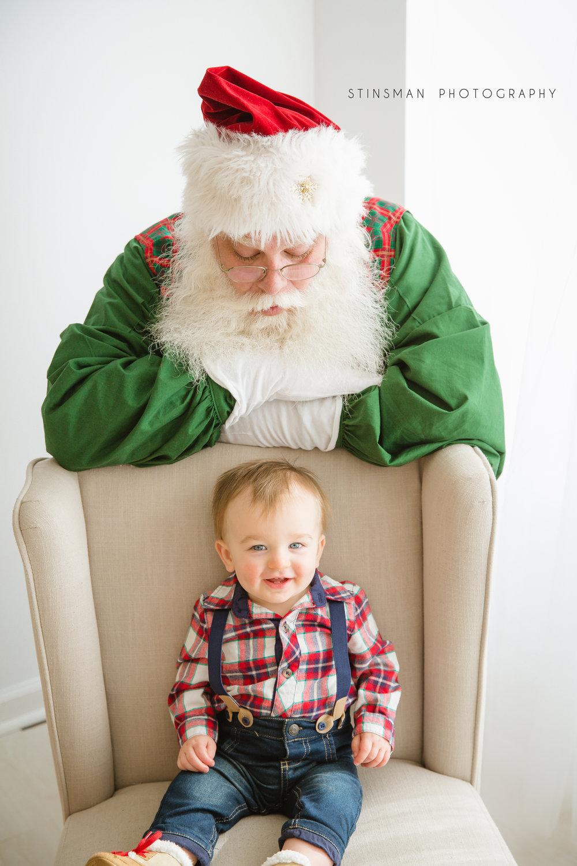 baby boy smiling while Santa is behind him in burlington nj
