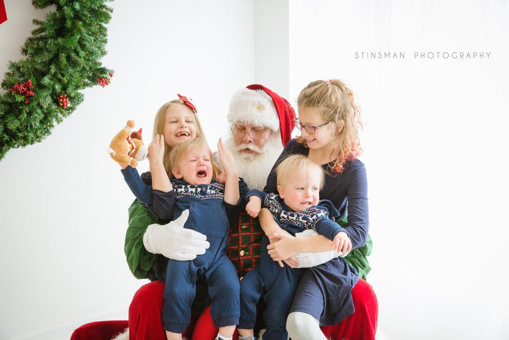 twin boys do not like santa but their older sisters do in burlington nj photo studio