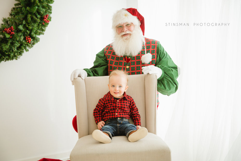 little boy sitting in a chair for his santa photo shoot in burlington nj picture studio