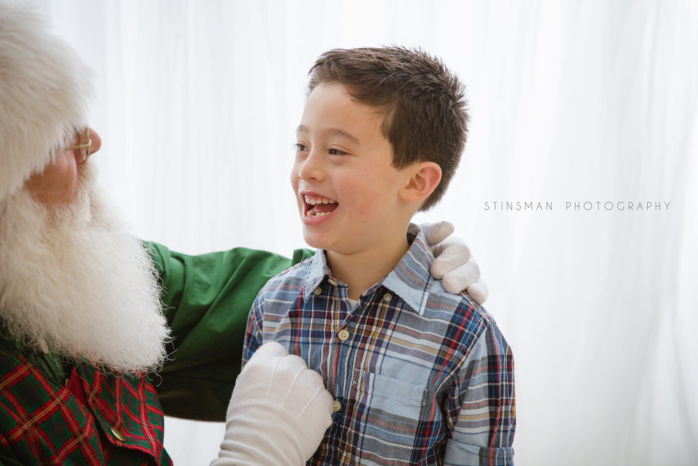 Santa checking out Tyler's lost tooth in burlington nj photo studio