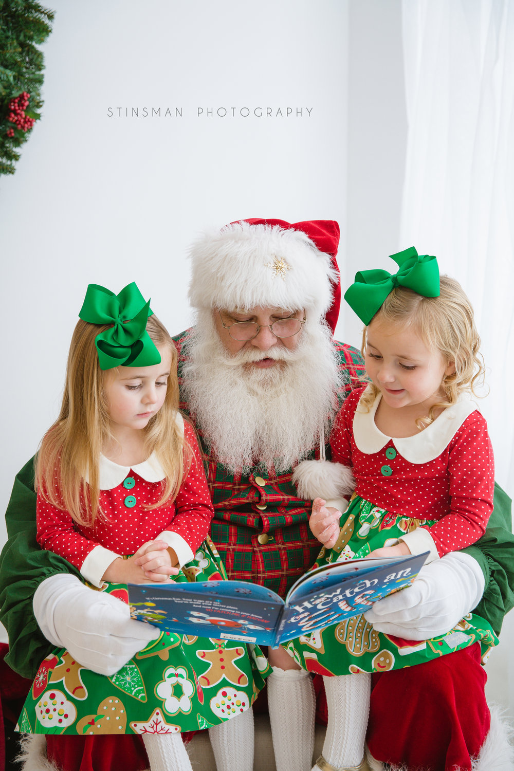 twin girls reading with Santa about how to catch an elf in burlington nj photo studio