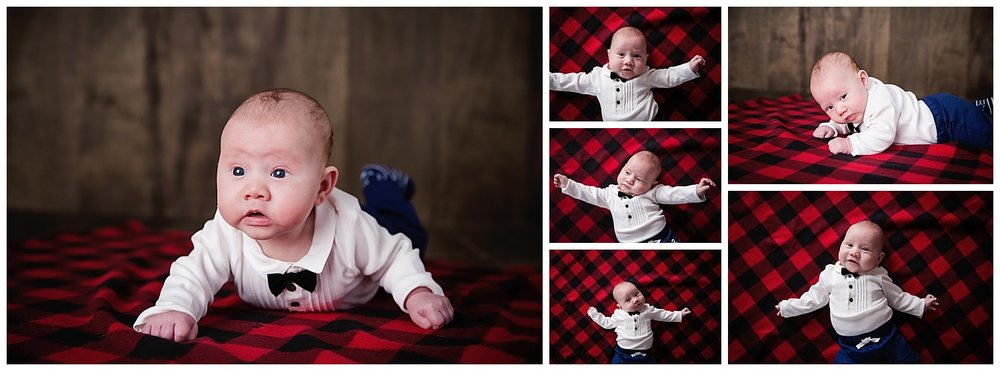 8 week old baby boy holding up his head in burlington nj photo studio session with flannel blanket