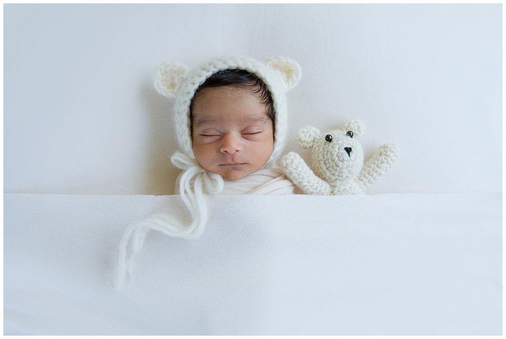 indian baby boy with a bear for his newborn photo shoot in boorhees new jersey photo session