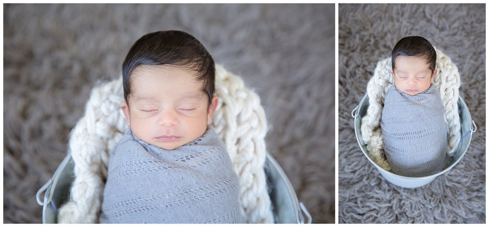 baby boy wearing grey for newborn photos in his voorhees new jersey home