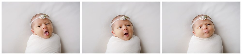 Baby girl wrapped in cream wearing a flower headband yawning and tired