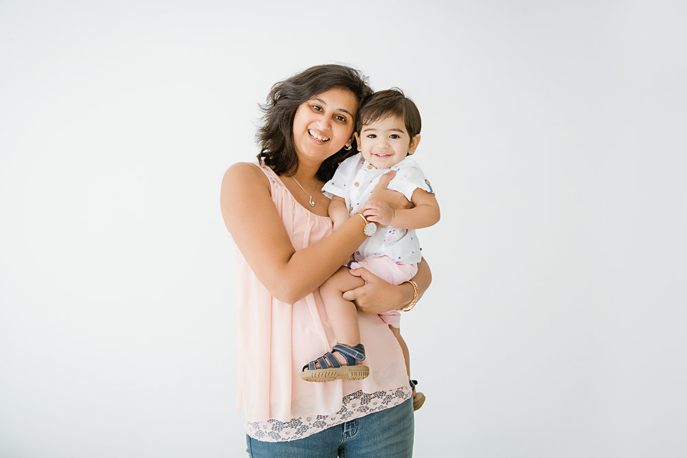 indian mom holding her son