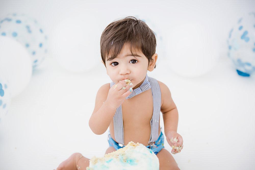 eating cake one year old boy