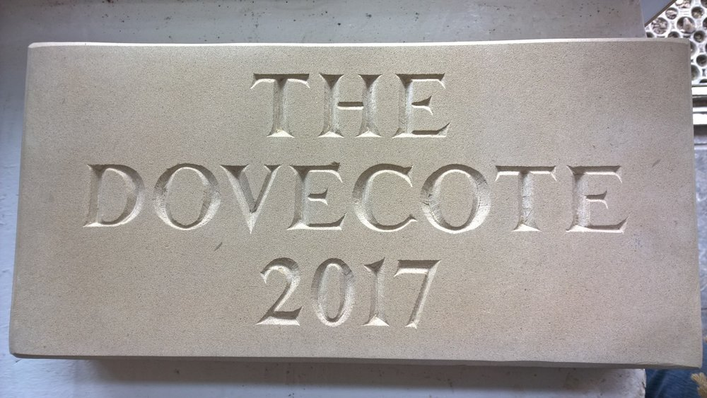 New stone sign ready for gable end of the Dovecote holiday cottage in stoke bruerne